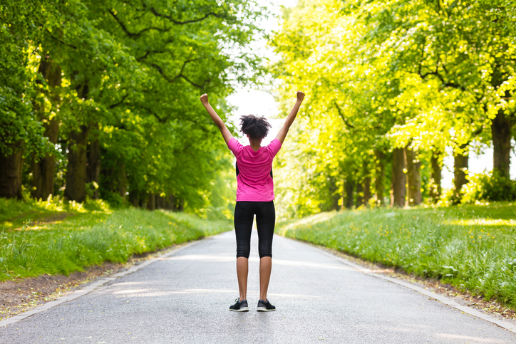 African American woman exercising outside spring summer