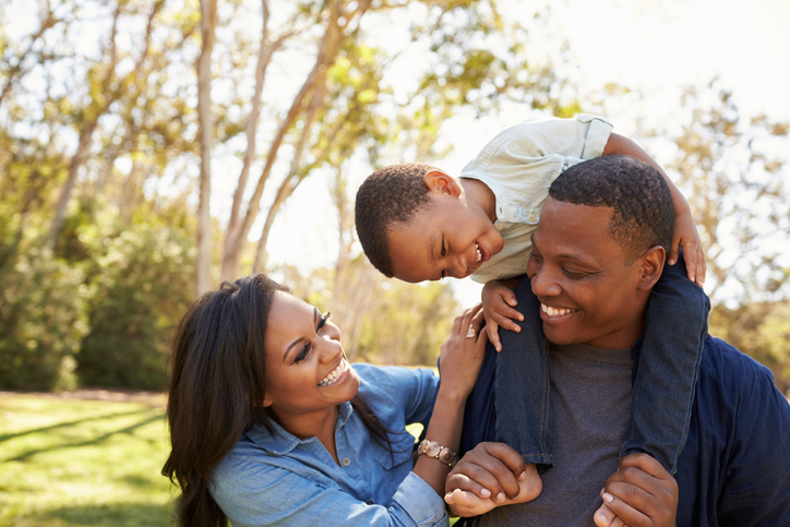 African american parents and son outside