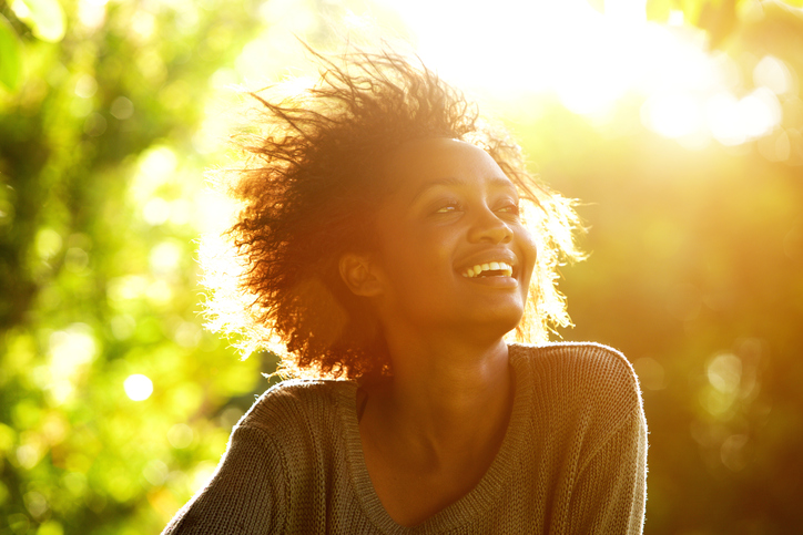 African American woman smiling sun