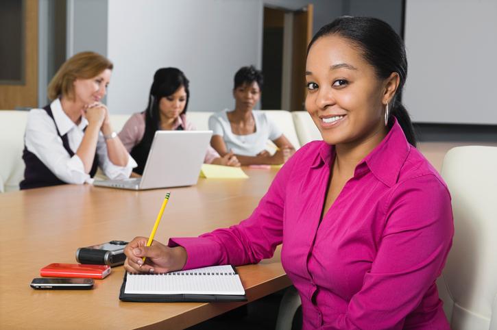 African American woman in work meeting