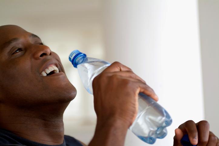 African American man drinking bottle water