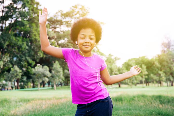 African American girl dancing happy outside