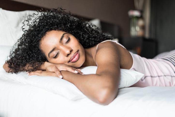 African American woman in bed sleeping