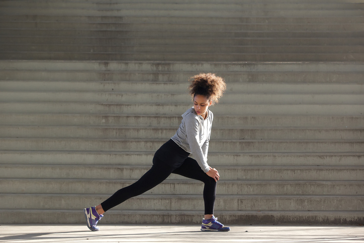 Young African American woman exercise leggings