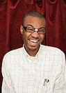 african american nerdy guy with tape on his glasses