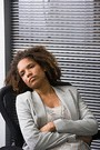 african american woman sitting in chair, not feeling well