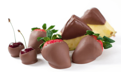 A variety of different types of chocolate-dipped fruit