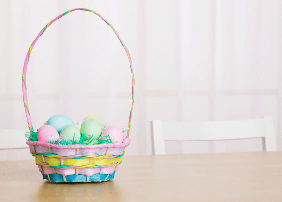 An easter basket sitting on a kitchen table