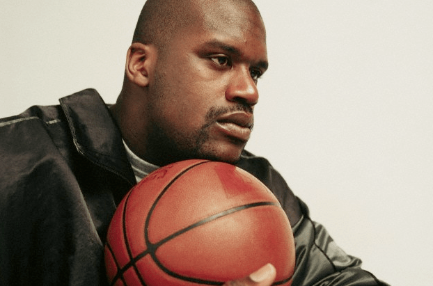 Shaquille O'Neal posing with a basketball