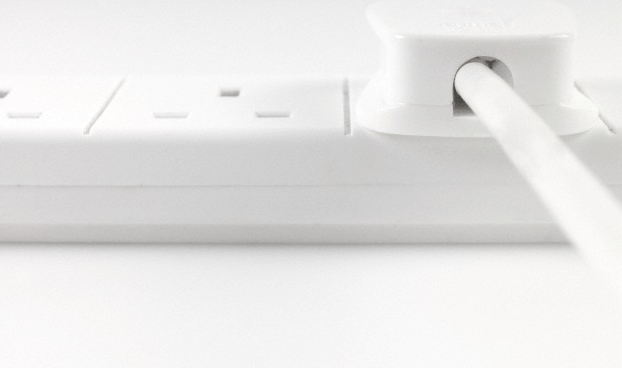 A Charger Plug Attached To An Electrical Socket