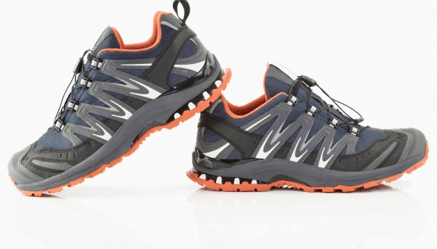 A pair of gray and orange running shoes