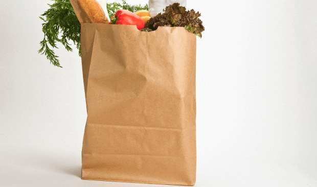 A large brown paper bag filled with groceries