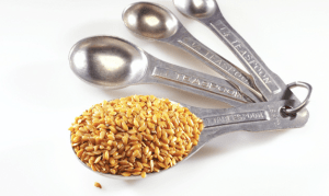 Flax seed in a measuring spoon