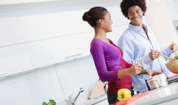 couple-cooking-together-in-kitchen