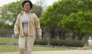 An older woman walking in a park