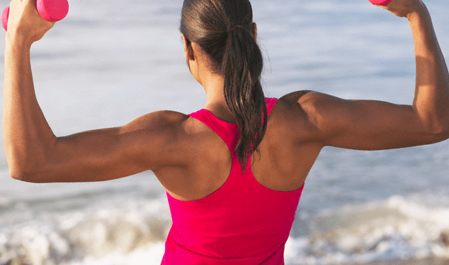 woman working out at beach