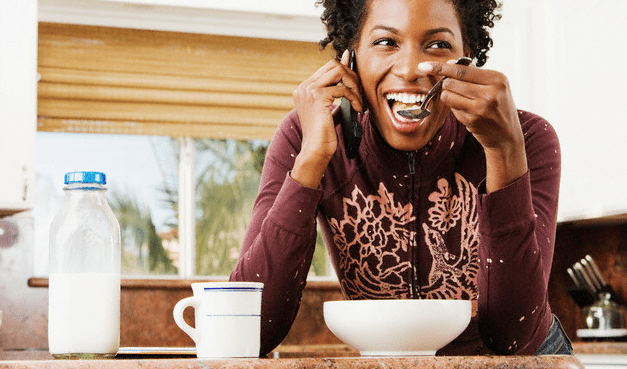A woman eating breakfast cereal
