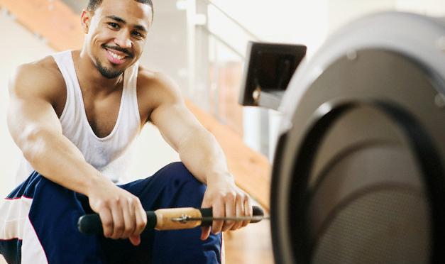 A man sitting on a rowing machine