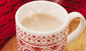 A red mug of hot chocolate