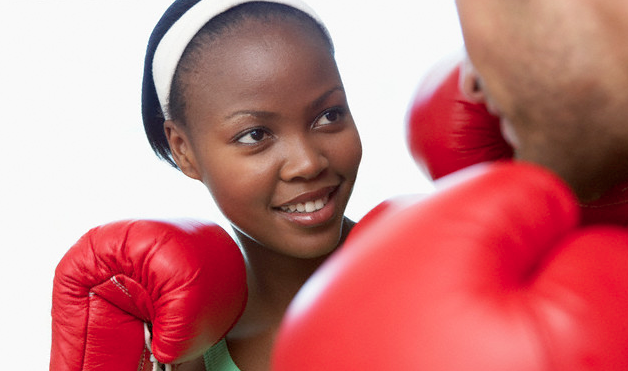 couple boxing with red gloves