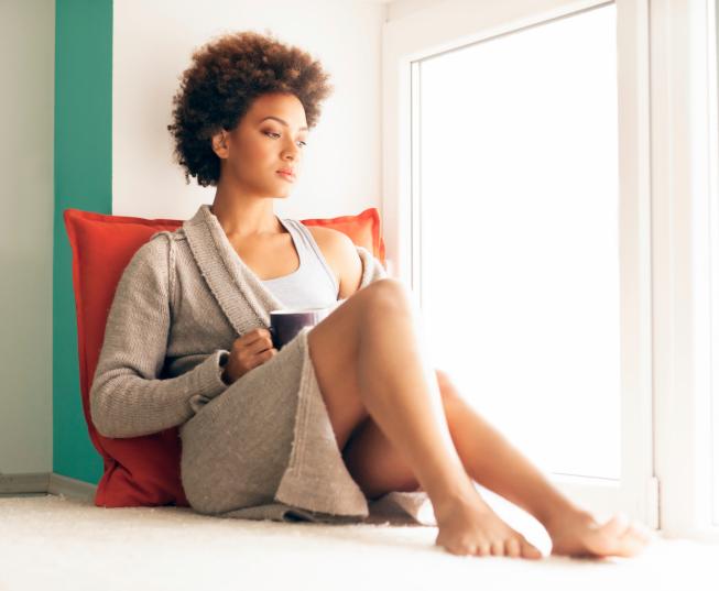 african american woman coffee sad