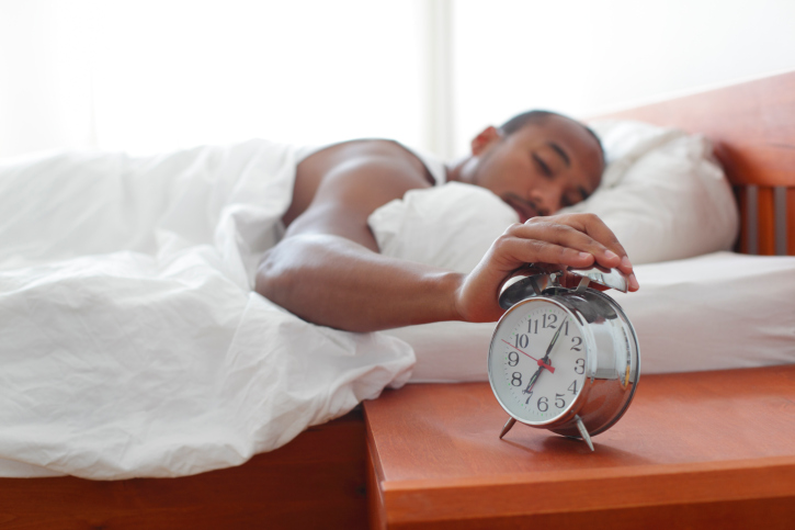 man sleeping clock