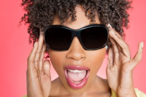 close up of african american woman wearing sunglasses