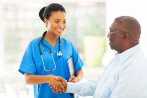 female doctor shaking patients hand