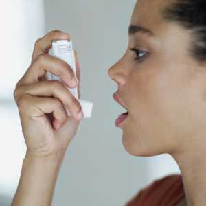 side profile of woman about to use an inhaler