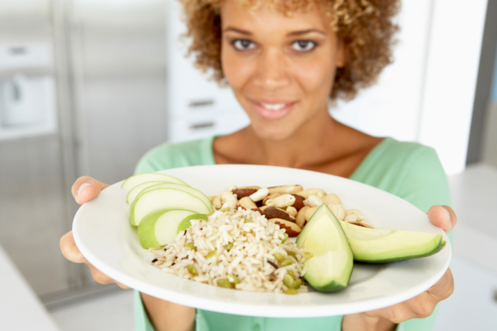 woman with plate of healthy food