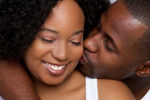 couple kiss on cheek