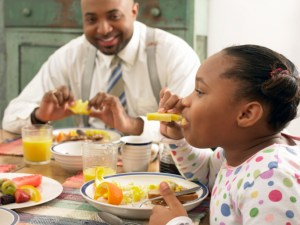 African american family having breakfast