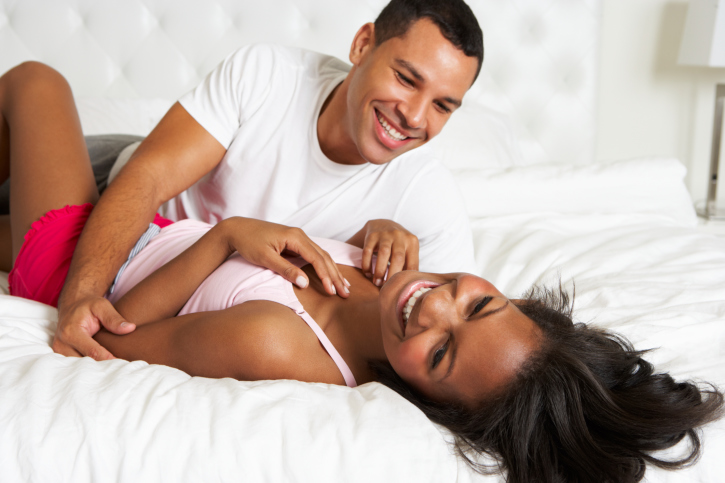 couple playful in bed