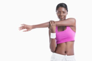 african american woman stretching in the gym