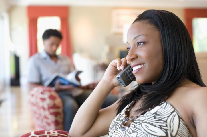 woman on cordless phone
