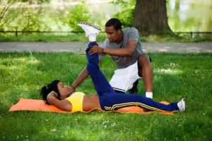 African American Black Couple Working Out In Park On Grass