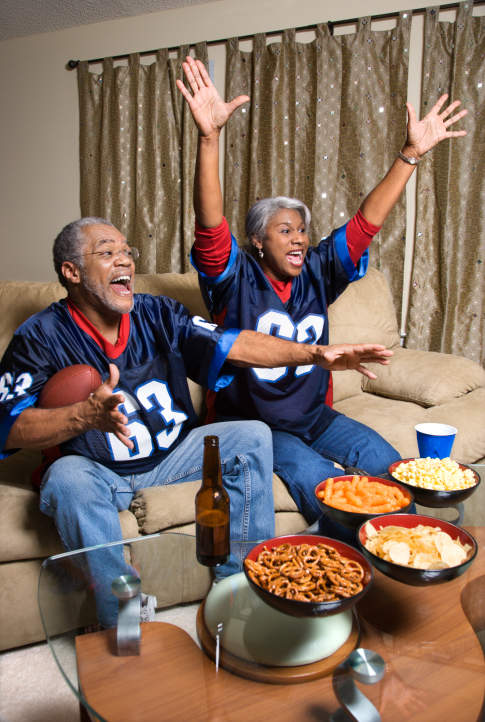 Couple watching sports on TV.