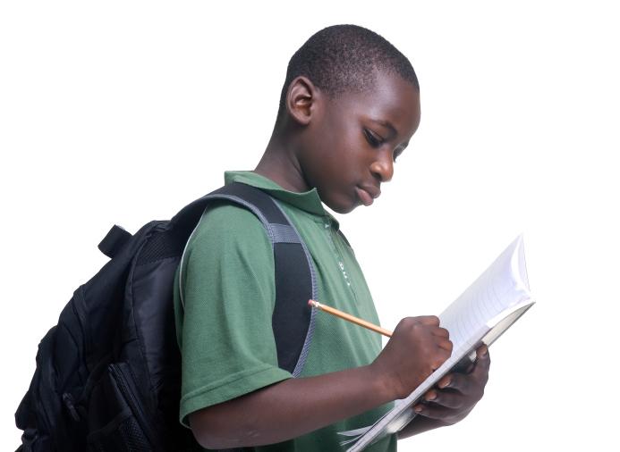 boy writing notebook
