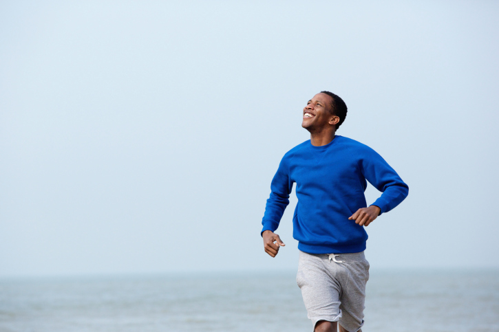man jogging on beach