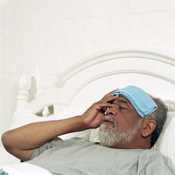 sick man lying in bed