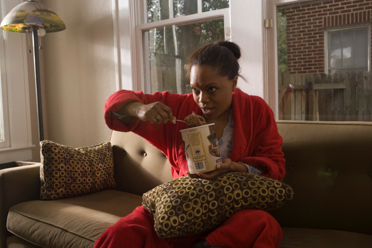 woman on couch eating ice cream