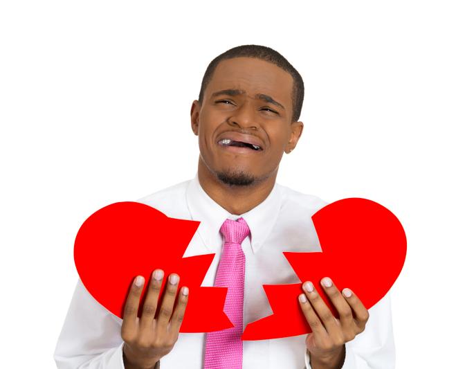 man holding broken heart