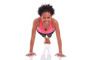 young african american woman doing push up