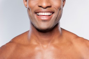 African American man smiling with white teeth