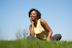 woman sitting in grass smiling