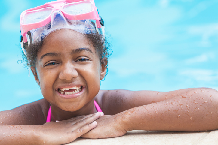girl in swimming pool smiling