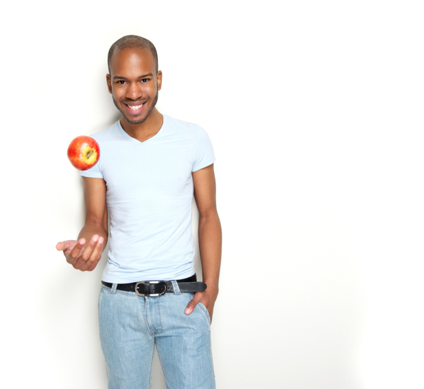 smiling man with apple