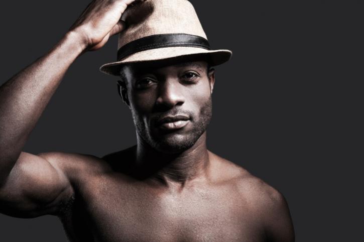 shirtless man in hat