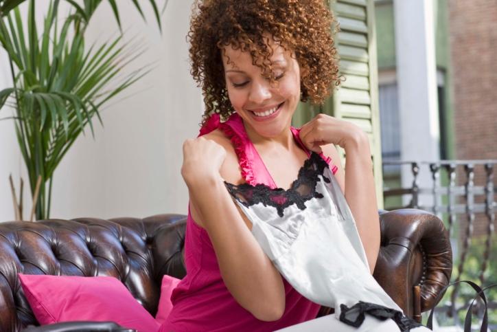 Woman holding lingerie