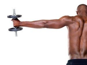 man holding dumbbell in hand
